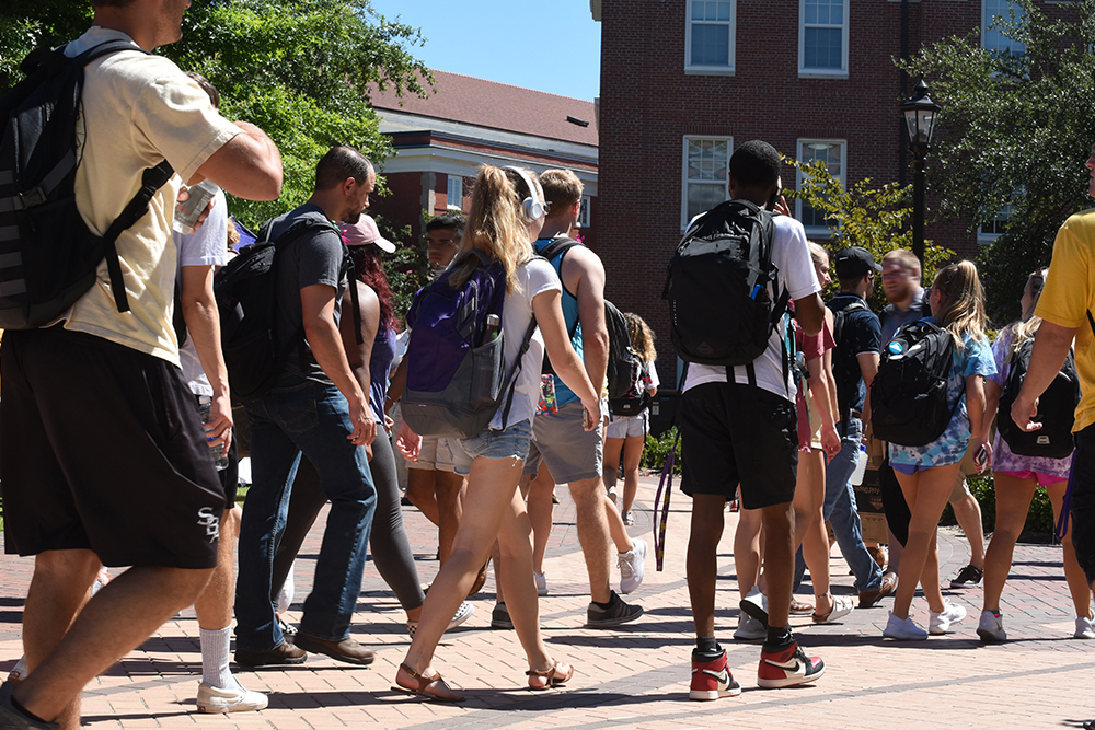 Students outside walking to class on a sunny day